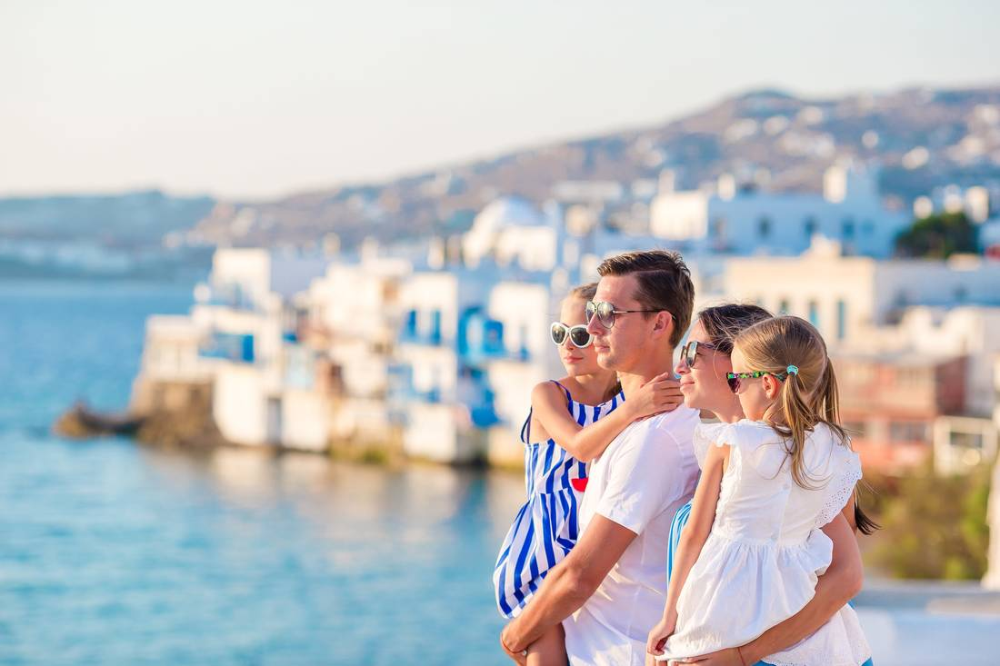 Caucasian family overlooking ocean in Greece